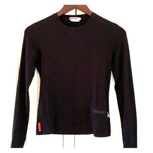 Prada top with red logo stripe and pocket detail